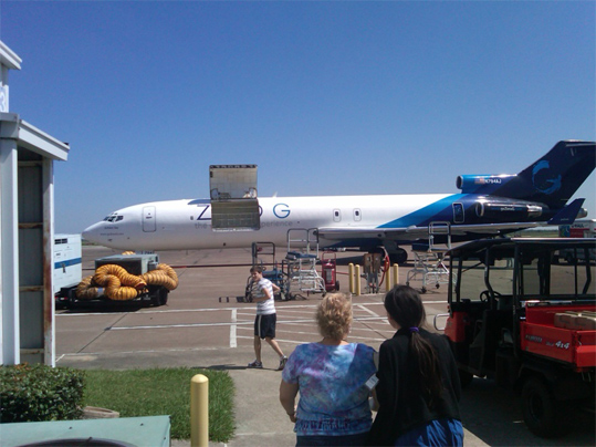 The Zero G 727 aircraft during loading prior to takeoff. DMI and NASA team members in the foreground and background.